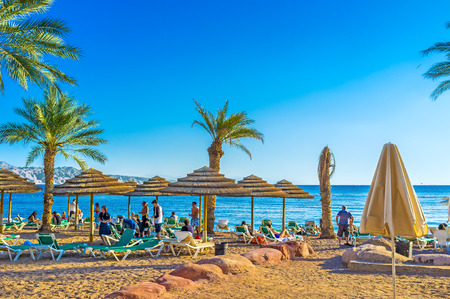best way: EILAT, ISRAEL - FEBRUARY 23, 2016: The best way to relax in Eilat is to visit local beach and to swim, on February 23 in Eilat.