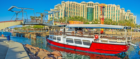 pleasure boat: EILAT, ISRAEL - FEBRUARY 23, 2016: The pleasure boat moored next to the entrance to Marina in the city center, on February 23 in Eilat.
