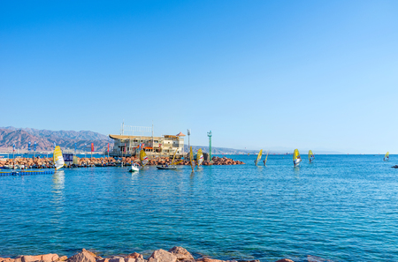 windsurfers: EILAT, ISRAEL - FEBRUARY 23, 2016: The windsurfers back to the harbor after the competitions, on February 23 in Eilat.