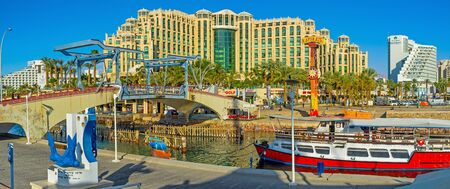 drawbridge: EILAT, ISRAEL - FEBRUARY 23, 2016: The entrance to the Marina with the Memorial drawbridge and Hilton Hotel Complex on the background, on February 23 in Eilat.