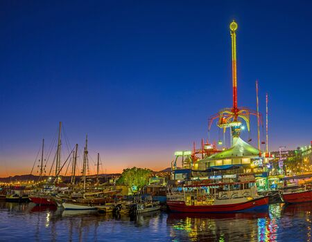 brightest: EILAT, ISRAEL - FEBRUARY 24, 2016: The amusement park becomes one of the brightest, noisiest and colorful places in the evening, on February 24 in Eilat.