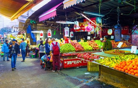 TEL AVIV, ISRAEL - FEBBRUARY 25, 2016: The different fruits in Carmel market stall attract the clients, on February 25 in  Tel Aviv.