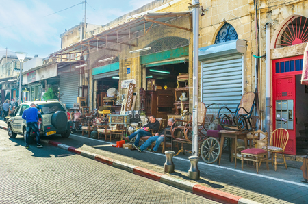 yafo: TEL AVIV, ISRAEL - FEBBRUARY 25, 2016: The whole street of used furniture stores in the large flea market in old Jaffa, on February 25 in  Tel Aviv.