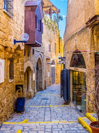 yafo: TEL AVIV, ISRAEL - FEBBRUARY 25, 2016: The narrow winding street of Jaffa hides the tiny stalls and interesting art galleries, on February 25 in  Tel Aviv. Editorial