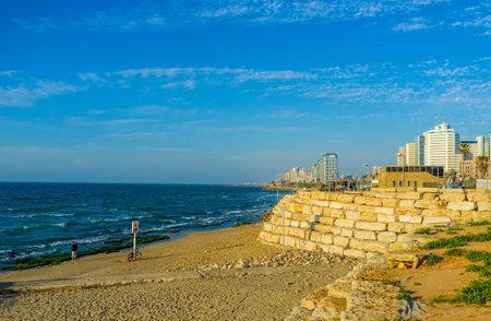 highrises: TEL AVIV, ISRAEL - FEBBRUARY 25, 2016: The seashore with the narrow Alma beach line and modern high-rises on the background, on February 25 in  Tel Aviv.