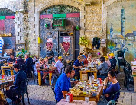yafo: TEL AVIV, ISRAEL - February 25, 2016: Jaffa is famous for the best shakshuka omelet in city, the local cafes are always full of clients, on February 25 in  Tel Aviv.