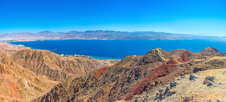 The scenic colorful landcape of Eilat mountains with Aqaba Gulf in the distance, Israel.