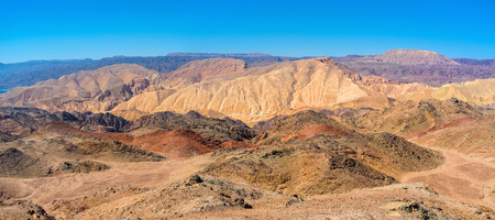 The red, yellow, brown and grey slopes of Eilat mountains, Israel.