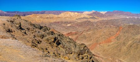 The colorful desert located next to Eilat resort in the same named mountains, Israel. Stock Photo