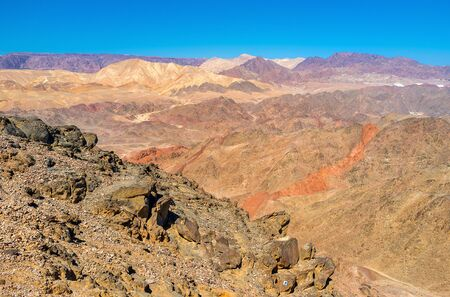 The desert of Eilat mountains boasts the amazing colors, perfectly seen from Zefahot peak, Israel.