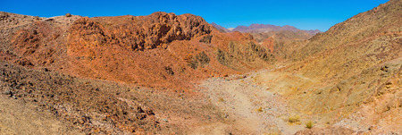 The Eilat mountains look like painted or like fairy land with bright colors, changing on each slope, Israel.