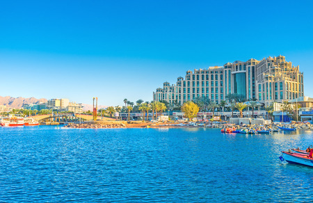 eilat: EILAT, ISRAEL - FEBRUARY 23, 2016: The coastal district of resort with the harbor, luxury hotel complex and shopping street, on February 23 in Eilat.