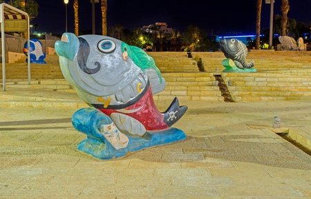 eilat: EILAT, ISRAEL - FEBRUARY 23, 2016: The sculpture of the fish in painted pirate dress, on February 23 in Eilat.