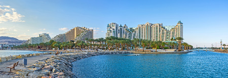 The new harbor with the scenic stone pier is the best place to overlook the center of the beautiful resort of Eilat, Israel. 写真素材