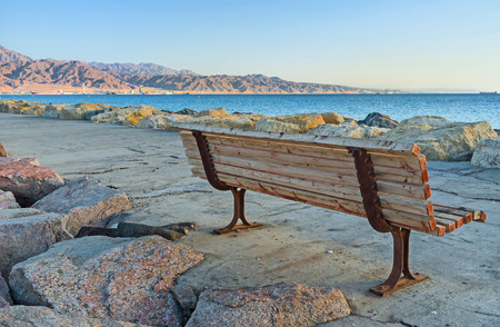 eilat: The new harbors pier is equipped with the wooden benches, faced on sea, Eilat, Israel.