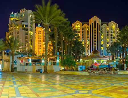 eilat: EILAT, ISRAEL - FEBRUARY 24, 2016: The night street with the modern hotel complex, on February 24 in Eilat.