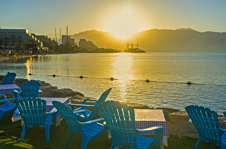 best place: The beach cafe is the best place to watch the bright sunshine over Aqaba Gulf, Eilat, Israel. Stock Photo