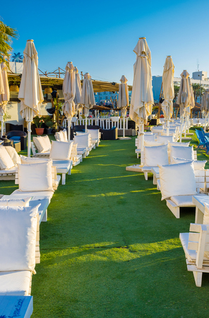 eilat: EILAT, ISRAEL - FEBRUARY 24, 2016: The white benches with the fluffy pillows for the best relax on central beach, on February 24 in Eilat.