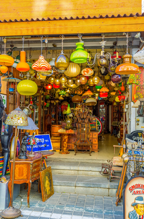 furniture store: TEL AVIV, ISRAEL - FEBRUARY 25, 2016: The store offers retro lamps, chandeliers and used furniture, on February 25 in  Tel Aviv. Editorial