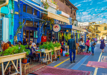 TEL AVIV, ISRAEL - FEBRUARY 25, 2016: The flea market neighborhood of old Jaffa is full of the cozy cafes, decorated with plants in pots, colorful rugs and wooden details, on February 25 in  Tel Aviv.