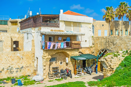 acre: ACRE, ISRAEL - FEBRUARY 20, 2016: The small garage in the yard of the old stone house, here locals repair their bikes, on February 20 in Acre. Editorial