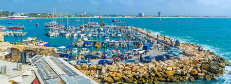 acre: ACRE, ISRAEL - FEBRUARY 20, 2016: The sailing yachts and the fish boats in marina of Akko, one of the best city locations, on February 20 in Acre.