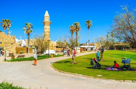 best way: CAESARIA, ISRAEL - MAY 19, 2016: The best way to relax in National Park is to visit local cafe or just have picnic on the grass among the ancient landmarks, on May 19 in Caesaria. Editorial