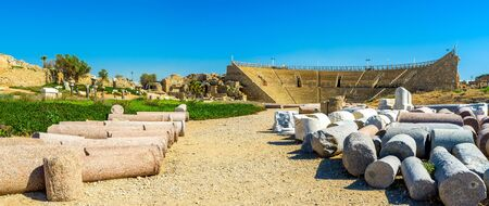 caesarea: The ancient Roman Colosseum with the lying ruined columns on the foreground, Caesarea, Israel.