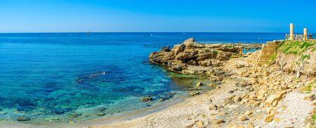 caesarea: The cozy beach of Caesarea boasts the unique views on the ruins of the ancient Roman settlement, Israel.