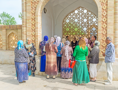 baha: BUKHARA, UZBEKISTAN - APRIL 29, 2015: The common prayer in the summer pavilion of Bahauddin Nakshbandi complex, on April 29 in Bukhara.