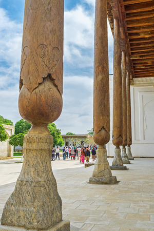baha: BUKHARA, UZBEKISTAN - APRIL 29, 2015: The close-up of the carved wooden pillar of the mosque in Bahauddin Nakshbandi complex, on April 29 in Bukhara.