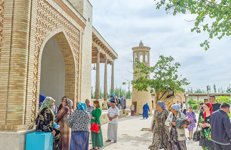 baha: BUKHARA, UZBEKISTAN - APRIL 29, 2015: The numerous religious tourists visit the Bahauddin Nakshbandi complex, on April 29 in Bukhara.