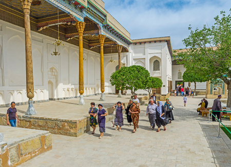 baha: BUKHARA, UZBEKISTAN - APRIL 29, 2015: The group of pilgrims in the courtyard of Sheikh Naqshband Mausoleum, on April 29 in Bukhara. Editorial