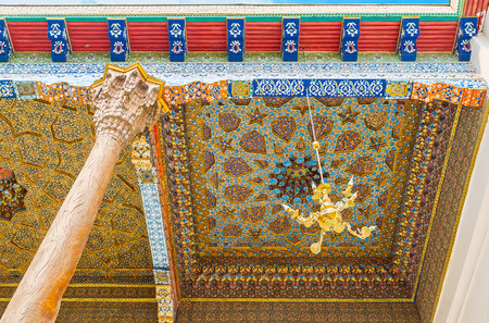 baha: BUKHARA, UZBEKISTAN - APRIL 29, 2015: The colorful stars, tiny flowers, winding lines and unique figures cover the ceiling in Sheikh Nakshbund Mausoleum, on April 29 in Bukhara.