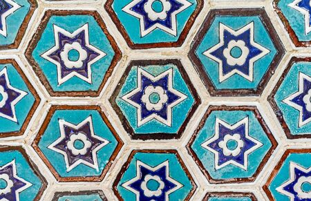 stellar: The close-up of hexagonal glazed tiles with blue stellar pattern, Chor-Bakr Necropolis, Bukhara, Uzbekistan.