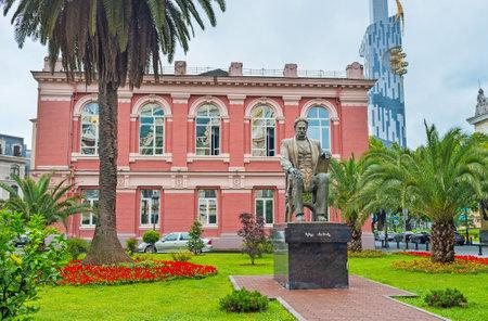 argonaut: BATUMI, GEORGIA - MAY 24, 2016: The Memed Abashidze statue among the greenery in the Europe Square, on May 24 in Batumi.