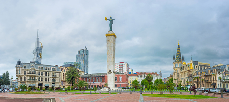 argonaut: The statue of Medea with the golden fleece topped the high stone column in center of the Europe Square, surrounded by scenic mansions, luxury hotels and restaurants, Batumi, Georgia.