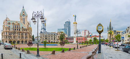 argonaut: BATUMI, GEORGIA - MAY 24, 2016: Panorama of the Europe Square with Medea monument, beautiful mansions with towers and old lamp clock, on May 24 in Batumi. Editorial