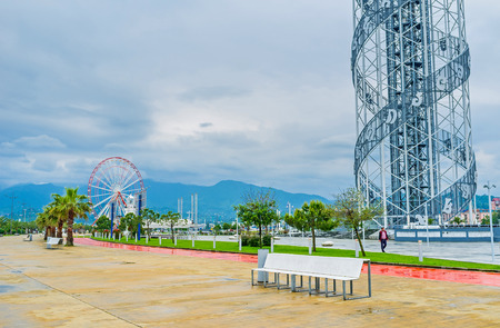 alphabetic: BATUMI, GEORGIA - MAY 24, 2016: The view on the Miracle Park with the foot of the Alphabetic Tower and the ferris wheel on background, on May 24 in Batumi.