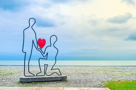 love confession: BATUMI, GEORGIA - MAY 24, 2016: The sculpture of a couple, making the love confession on the beach, on May 24 in Batumi.