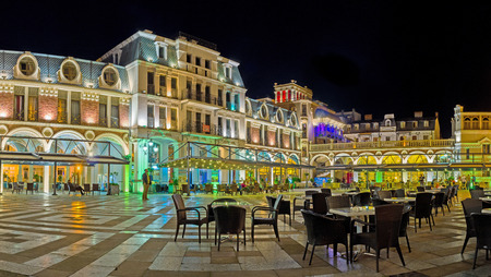 restaurant tables: BATUMI, GEORGIA - MAY 24, 2016: The outdoor cafe on Piazza Square, surrounded by buildings of Piazza Inn, art galleries and souvenir stores, on May 24 in Batumi.