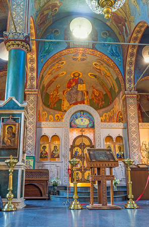 iconostasis: BATUMI, GEORGIA - MAY 24, 2016: The colorful murals on the apse of St Nicholas Church and the carved stone iconostasis, on May 24 in Batumi.