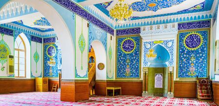 sunni: TBILISI, GEORGIA - MAY 28, 2016: The  interior of Jumah (Friday) Mosque, decorated with arabic inscriptions from Quran and floral ornaments in blue gamma, on May 28 in Tbilisi.