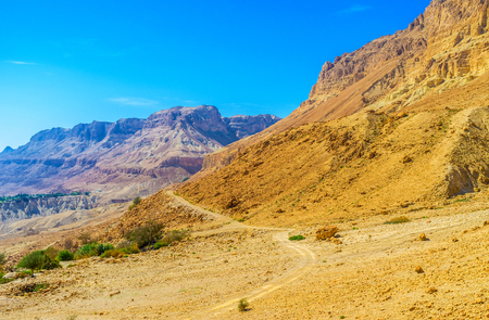 judean desert: The narrow footpath connects two scenic canyons of Ein Gedi Nature Reserve in Judean desert, Israel. Stock Photo