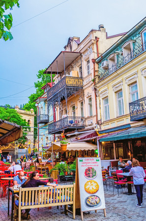 old towns: TBILISI, GEORGIA - MAY 28, 2016: Many of old towns streets occupied with family restaurants and cafes, offering the tasty dishes and local wine, on May 28 in Tbilisi.