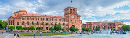 YEREVAN, ARMENIA - MAY 29, 2016: The red stone building with the clock tower is occupied by the Ministry of Transport and Armenian Government, on May 29 in Yerevan.