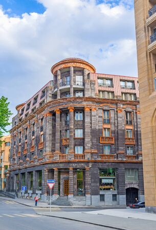 YEREVAN, ARMENIA - MAY 29, 2016: The Tufenkian Historic Hotel, occupied the scenic mansion of black and orange local stone, its located next to the Republic Square, on May 29 in Yerevan.