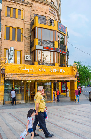 YEREVAN, ARMENIA - MAY 29, 2016: People enjoy the walk along the tourist street with many cafes and restaurants, on May 29 in Yerevan.