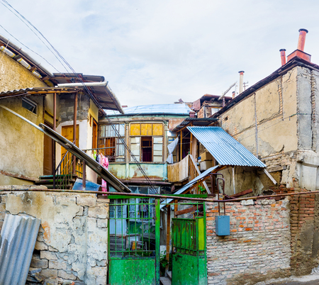 occupy: The slums occupy the large area in Tbilisi city center and consider as the landmark, Georgia. Editorial