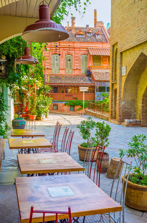best coffee: TBILISI, GEORGIA - MAY 29, 2016: The cozy outdoor cafe in  Shavteli street offers the best coffee in city, on May 29 in Tbilisi.